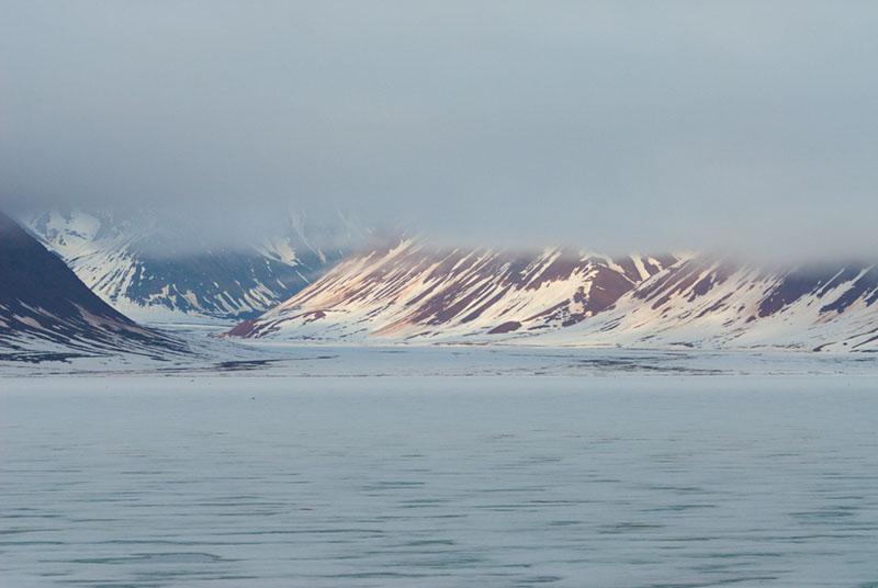 Beautiful sun rays falling thru the clouds illuminate Liedefjorden.