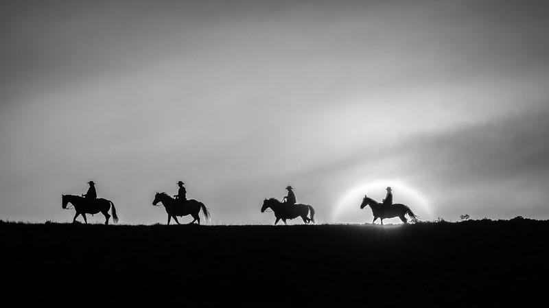 Riding through the rising sun