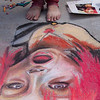 Spraying a completed work - Sidewalk art in chalk
