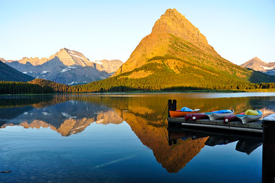 Early morning view of Mount Grinnell reflecting in Swiftcurrent Lake.