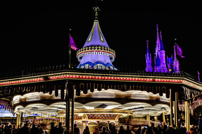 Prince Charming Regal Carousel and the Castle at night - Walt Disney World