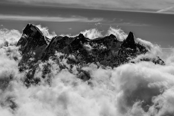 Peaking through the clouds.  Chamonix, France