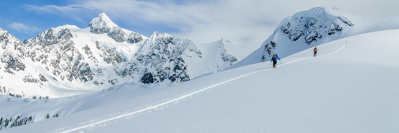 Skiers on  Mt Anne ridge, Mt Shuksan in the background, North Cascades, Washington