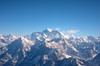 Mount Everest, or Mount Chomolungma, is the world's highest mountain above the mean sea level at 8,848 meters (29,029 ft) is visible at the center of the picture.  To its right is Lhotse, the fourth highest mountain on Earth (after Mount Everest, K2 and Kangchenjunga) and is connected to Everest via the South Col.