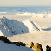 Peaking above the clouds in the Adamant Range, British Columbia