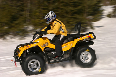 Snow-testing tires in Mattawa, Ontario on March 17, 2006. The snow was six feet deep two weeks prior to the test. An early thaw knocked down the snow to about three feet in depth. We could ride but had to use tracked ATVs to tow us out when we got stuck (which happened often). 1/90th at f22.