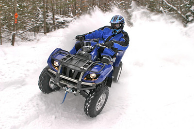 My friend Mark Frederick shredding with a quad near Park Falls, Wisconsin (yes, these trails are open to ATVs and dirt bikes in the winter). The photo was shot on February 21, 2004, and the temps were below zero when we woke up that morning. 1/200th at f6.7.