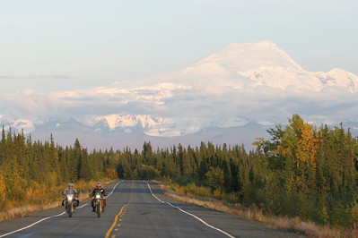 Motorcycle journalist Jamie Elvidge and actress and model Molly Culver riding in Alaska on September 5, 2003. 1/125th at F5.6.