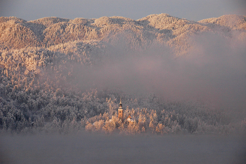 Lake Bled, Slovenia at sunrise: The Island peeks through the morning mist.