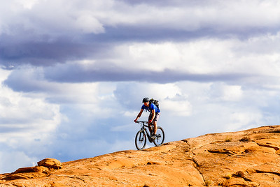 Riding a slickrock ridge, Moab, Utah
