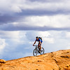 Riding a slickrock ridge, Moab, Utah