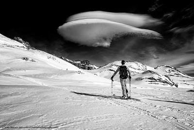 Skier and spaceship cloud, Mt Rainier backcountry, MRNP