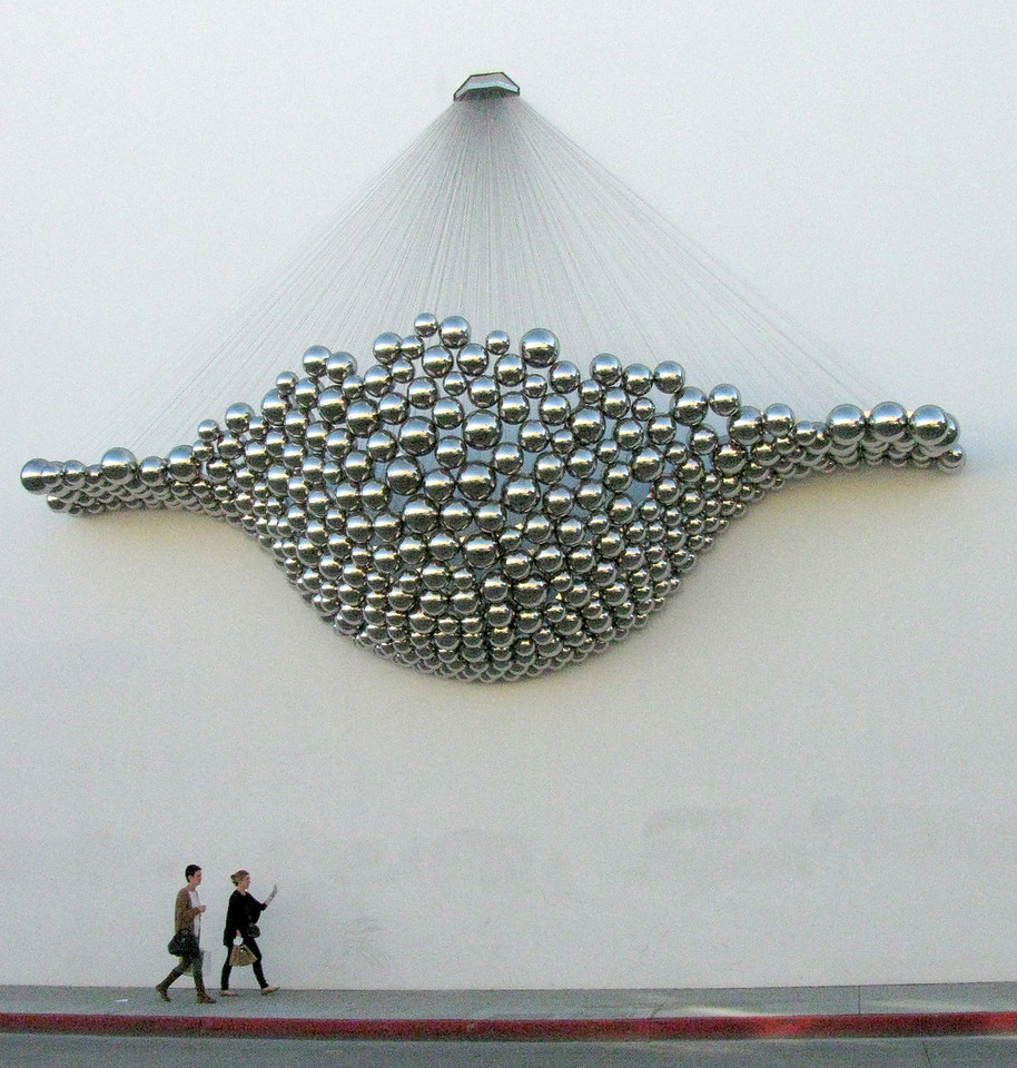 A sculpture on the wall of a parking lot in Santa Monica.