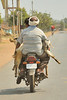 Two men, two goats and a motorcycle on the way to Kanha