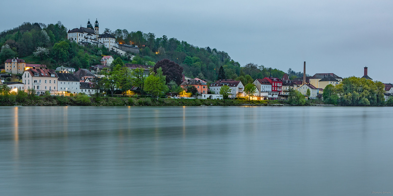 """Inn river flowing in to the """"Blue"""" Danube"""