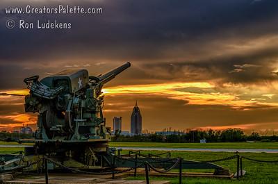 Sunset over Battleship Memorial Park in Mobile, AL