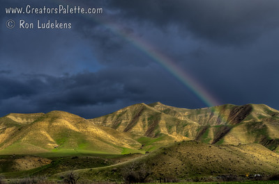 Spring rainbow over hills west of Coalinga.
