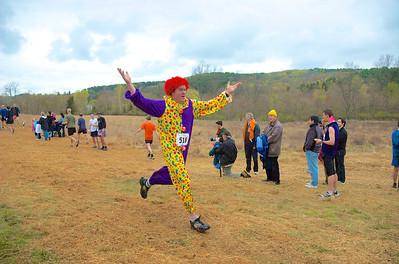 """Jim """"The Clown"""" Funk crosses the finish line in 2008. Photo by Ciorsdan Conran."""