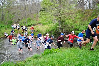 "Runners cross ""Sullivan's Surprise"" in 2012. Photo by Tom Casper."