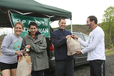 """Sam and David Ceisler accept donations for the Community Center of Northern Westchester in the 4th annual """"Help Feed The Leatherman"""" food drive at the Loop 2012."""