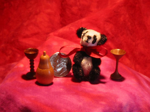 Becky's miniature hand sewn panda bear with my miniature wood turnings. The turnings are two goblets and a pear shaped lidded box.   Shown with a dime for comparison.
