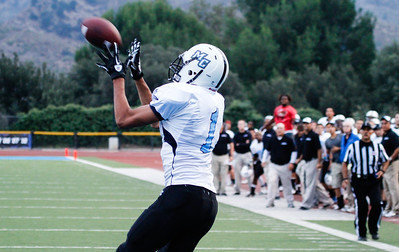Raider DeAndre Hutchins receives the ball for a touchdown as the team looks on at Griffin Stadium on September 10, 2011. The Raiders won the game against the Brahmas, 54-7. Photo by Jeffrey Farrar.