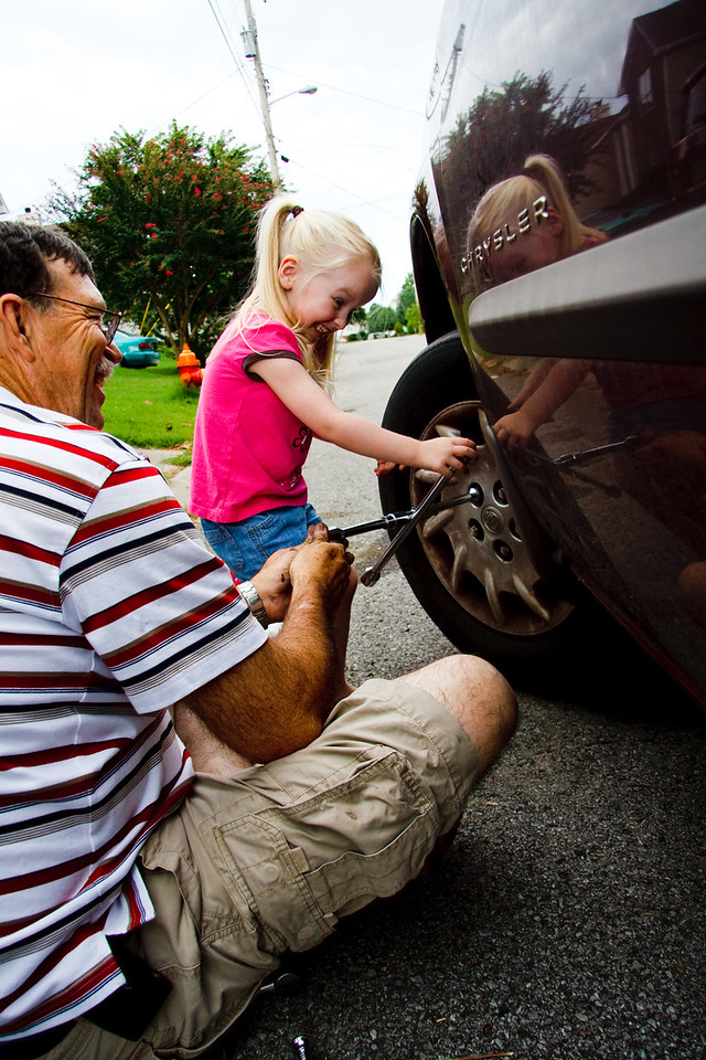 Grandpa changed the brakes on Jenn's van.  And Chloe helped! - August 2009