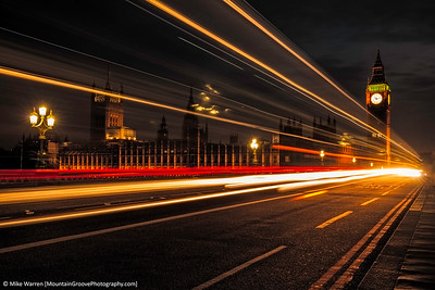 London long exposure catches the lights of a bus in front of Big Ben