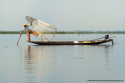 Fisherman using traditional techniques, Inle Lake, Myanmar.