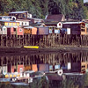Houses on the coast of Isla Chiloe, Chile