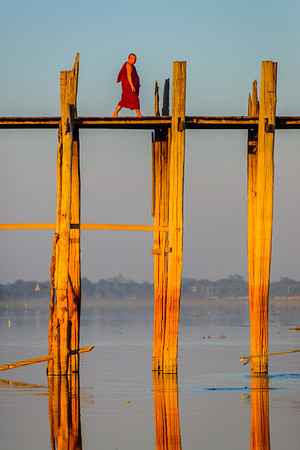 Burmese monk on U Bein bridge, Mandaly, Myanmar