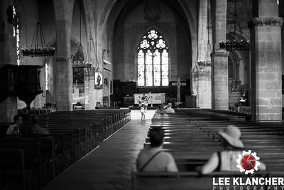 Guitarist playing in church in Tournon.