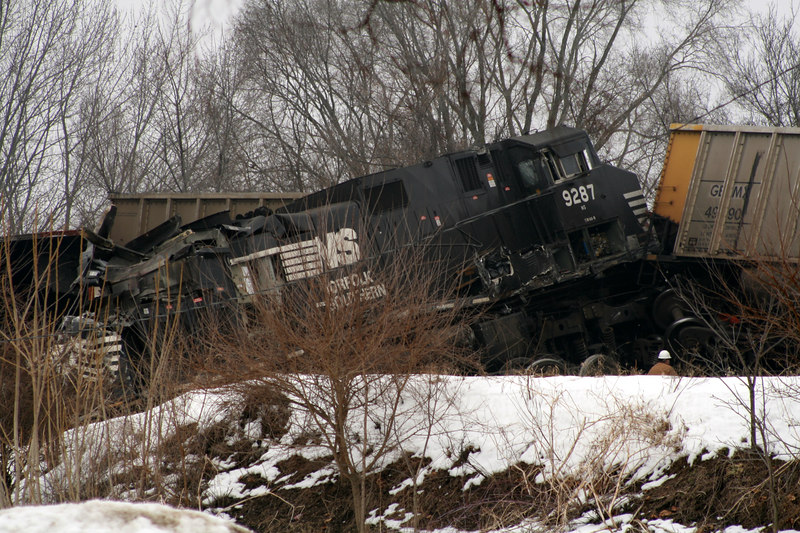 A shot about 1 hour after the train wreck in Goshen in Feb 2007. I like this because of the angles and the worker gives magnitude to the train wreck. Glad I had a 300mm lense for this situation!