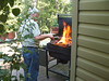 My dad grillin' at our family reunion. Another well timed shot. Now that's grillin'! :)