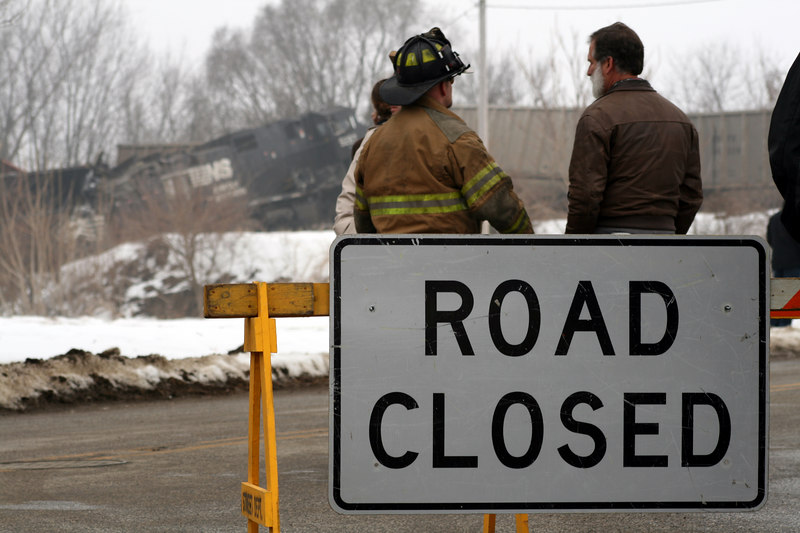 """Another shot about 1 hour after the train wreck in Goshen in Feb 2007. I like the perspective on this with the """"ROAD CLOSED"""" sign in the forground, then emergency workers, then the train wreck."""