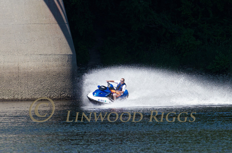 A jet skiier having fun on the Kennebec River in Augusta, Maine
