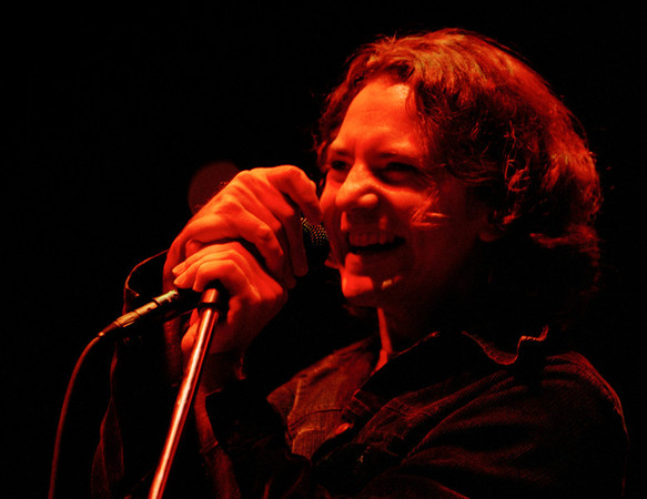 Photograph of Eddie Vedder, Pearl Jam in concert.