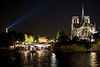 Eiffel Tower light, Seine River and Notre Dame