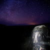 Ancestral Puebloan petroglyphs at night under the stars, Utah