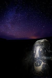 Ancestral Puebloan petroglyphs at night under the stars, Utah