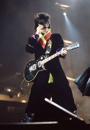 Photograph of Ronnie Wood, the Rolling Stones in concert.