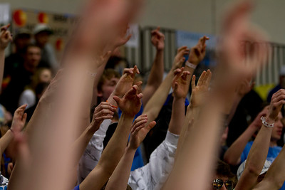The Malta student section fans hold up crossed fingers as the Malta vs. Forsyth semifinal matchup draws down to a nailbiter finish during the 2015 State B Basketball Tournament.