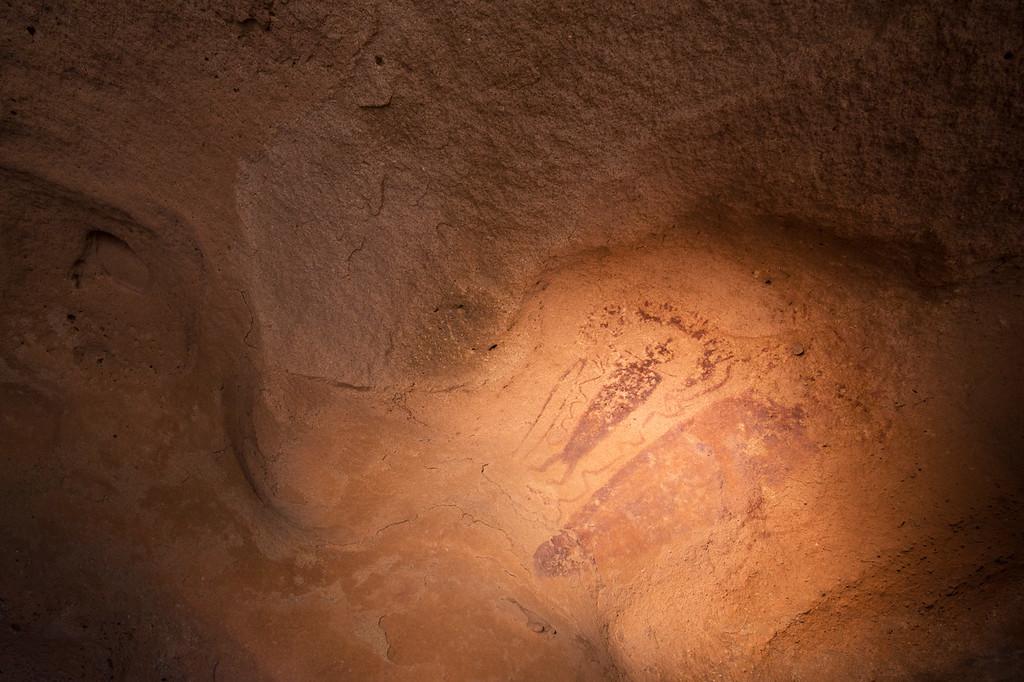 Anthropomorphs on the underside of a boulder, Barrier Canyon Style, Desert Archaic, Utah