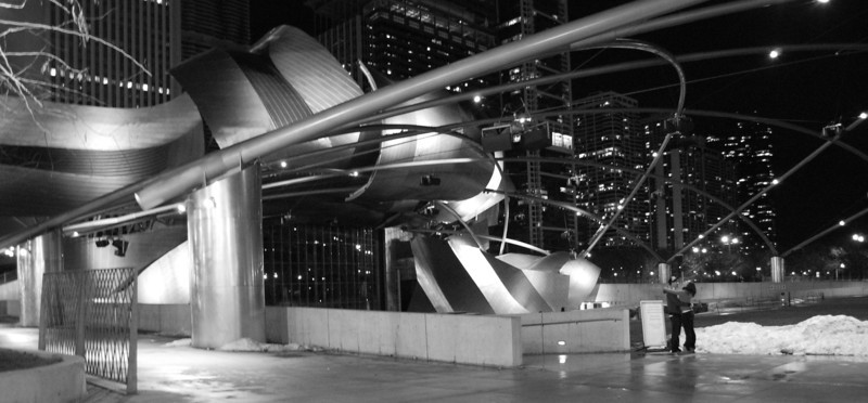 a couple by the jay pritzker pavilion in chicago's millennium park