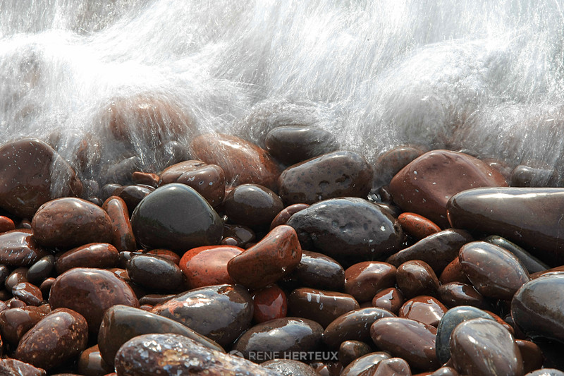 Wave splashing on Lake Superior rocks
