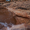 Owachomo Bridge with flash flood during sunset, Natural Bridges National Monument, San Juan County, Utah