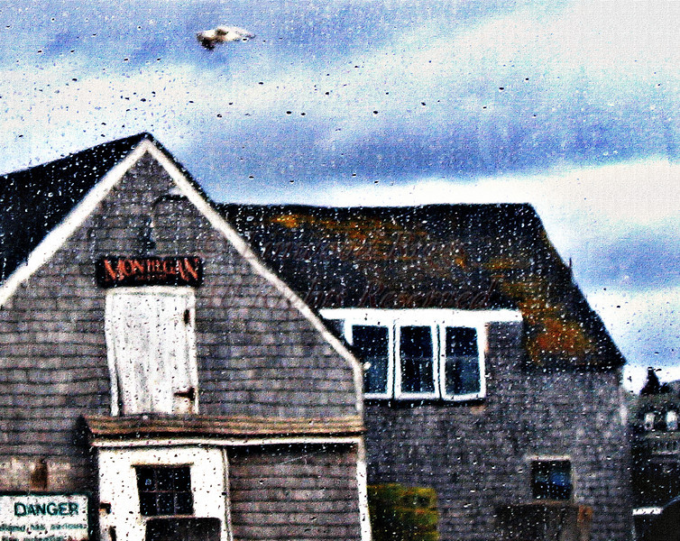 Monhegan Island, Maine, as seen through a rain-spattered plastic curtain of the Hardy III.