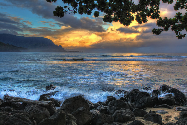 Looking west at daybreak off the northern coast of Kauai, brings a strange reflection of the eastern sunrise, #0769