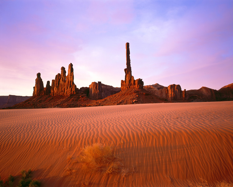 Totem Pole and the Yei Be Chai in Monument Valley, at dawn.