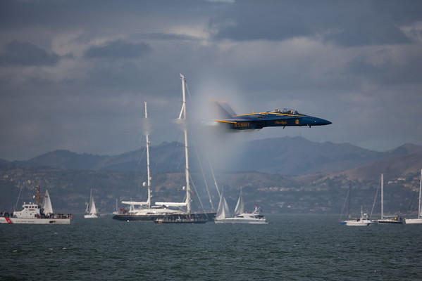 Sub-sonic sneak pass of F-18 with vapor Cone around the craft